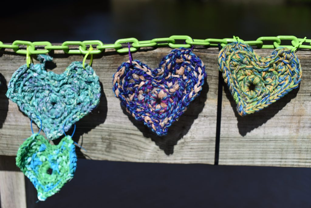 Chain of Knit Hearts by Artist Jane Reiter titled Chain of Compassion