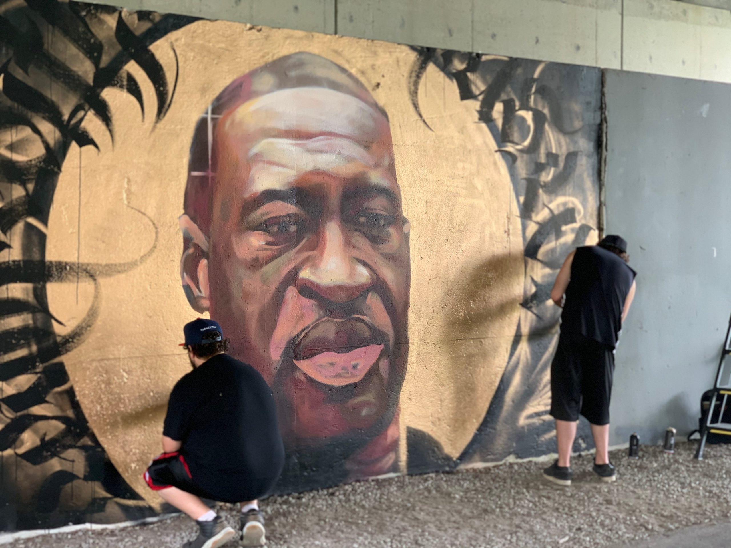 Artist Erik Phelps created the lettering on the mural that Isiah Lattimore painted.