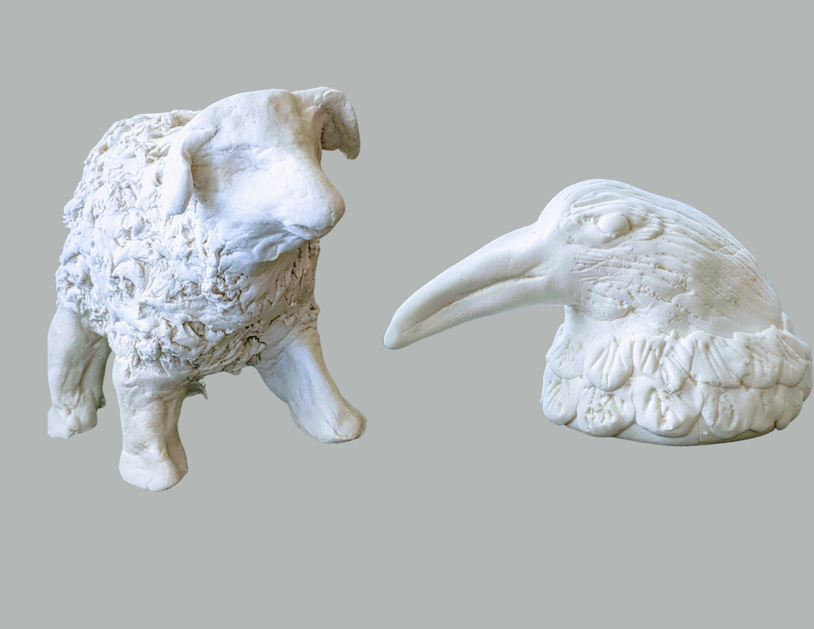 Clay sculpture of a sheep and bust of a crow